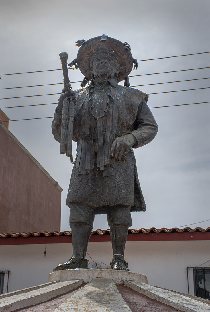 Statue of a Mayan leader , carrying the stick which is a symbol of authority in Chamula.
