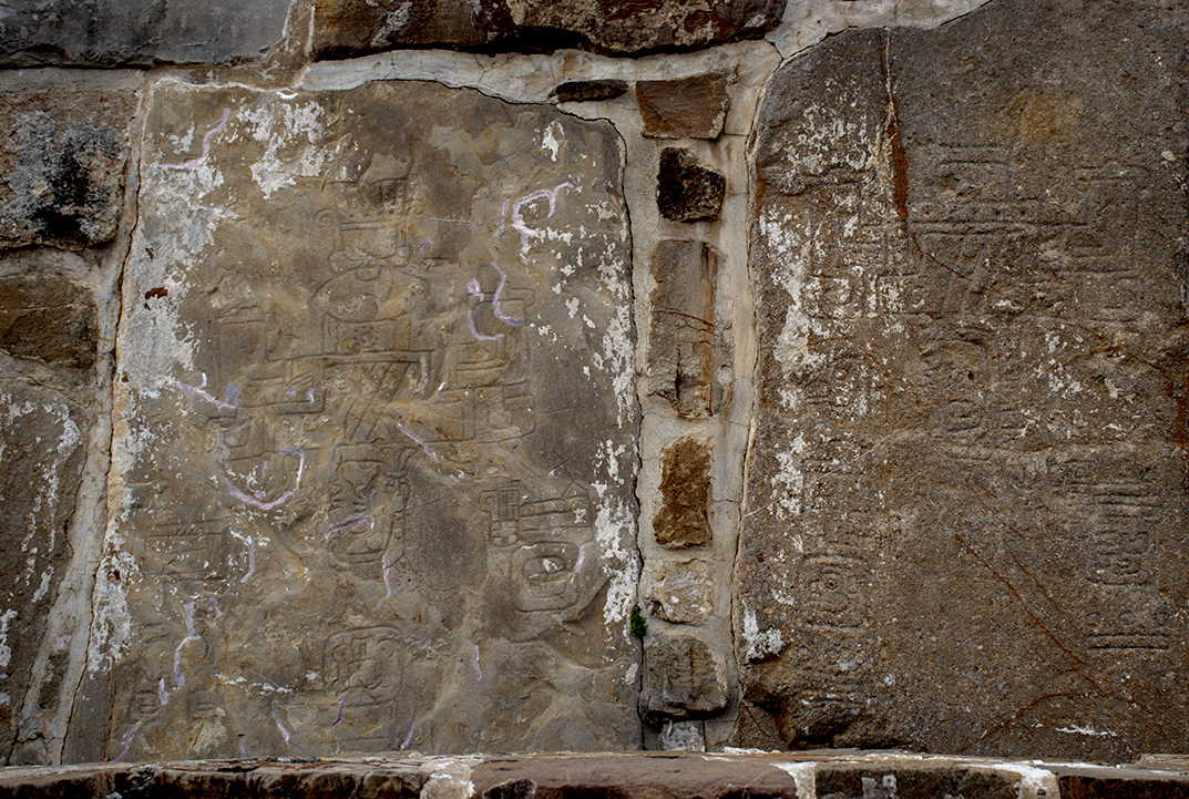 Glyphs carved into stone walls.