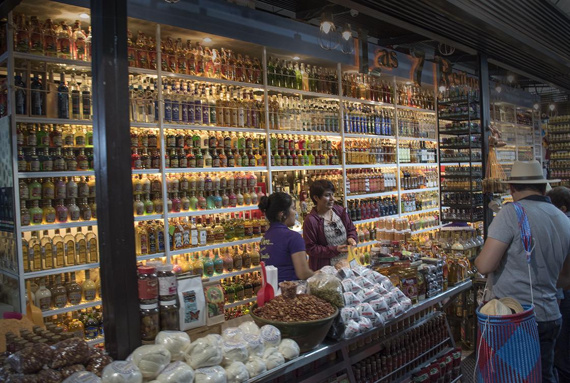 Shop with lots of mezcal at Benito Juarez market.