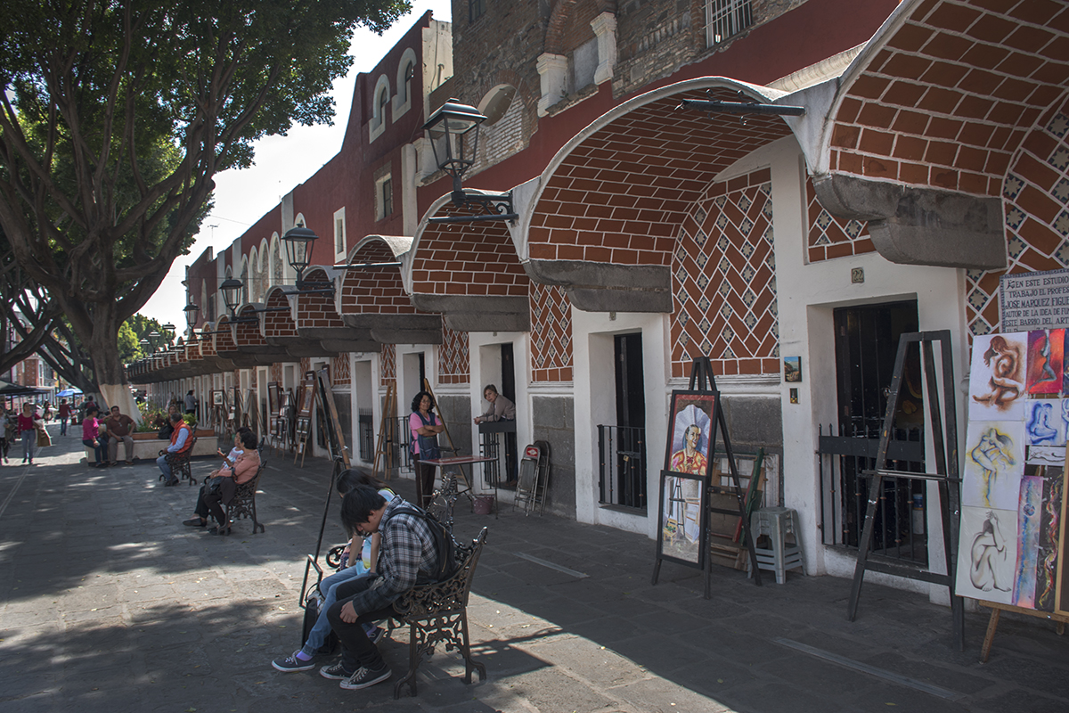 Barrio del Artista with a long row of artist's studios. Each door is one artist.