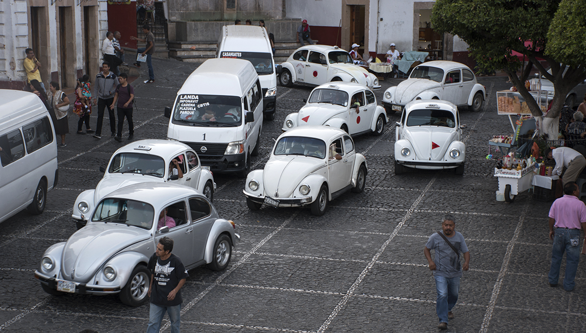 White Volkswagon Beetles used as taxis in Taxco.
